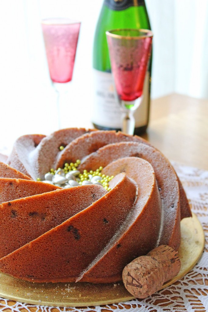 Pour a glass of Champagne to serve alongside this Celebratory Champagne and Raspberry Bundt Recipe from Supper in the Suburbs